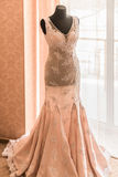 Wedding dress. On a mannequin in front of a window Royalty Free Stock Image