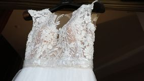 Wedding dress on a mannequin, lace of a wedding dress on a mannequin, wedding dress close-up. Wedding dress on a mannequin, white wedding dress on a stand stock video