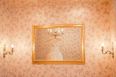 Wedding dress in the mirror Royalty Free Stock Photo
