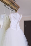 Wedding dress on mirror wardrobe Royalty Free Stock Images