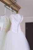 Wedding dress on mirror wardrobe Royalty Free Stock Images