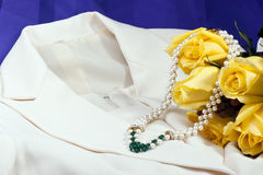 Wedding dress,necklace and roses Royalty Free Stock Image