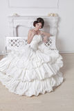 Wedding dress. Portrait of beautiful bride brunette woman. Weddi. Ng decoration. Modern interior Royalty Free Stock Photos