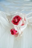 Wedding dress with red flower Stock Photography