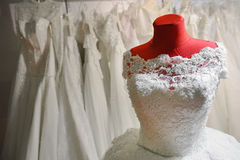 Wedding dress on red mannequin Stock Image