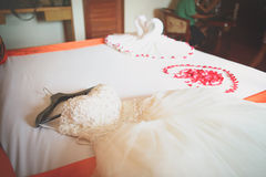 Wedding dress in room with rose petals Stock Images