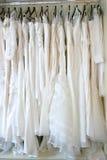 Wedding dress's. Choosing a wedding dress in a dress shop Royalty Free Stock Photos