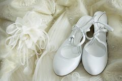 Morning of the bride before a betrothal. The wedding dress and shoes of the bride are spread out to beds stock image