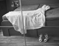 Wedding dress with shoes in mirror Stock Photos