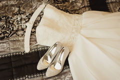 Wedding dress and shoes Stock Photography