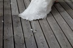 Wedding dress stitch on a wooden floor royalty free stock images
