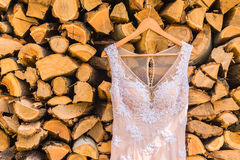 Wedding dress. On the tree on wood background Stock Image
