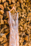 Wedding dress. On the tree on wood background Royalty Free Stock Photo