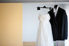 Wedding dress and a tuxedo hanging Stock Image