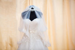 Wedding dress and veil on mannequin Royalty Free Stock Photos