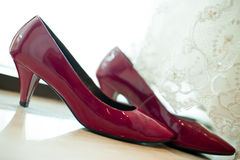 Wedding dress and wedding shoes Stock Photos