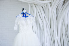 Wedding dress in the white room. 3 Stock Photo
