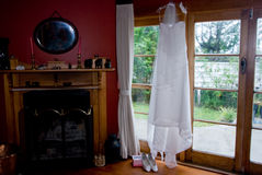 Wedding dress in window Royalty Free Stock Photography