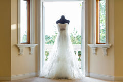 Wedding dress. Beside the window Stock Images