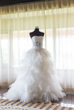 Wedding dress. Beside the window Royalty Free Stock Images