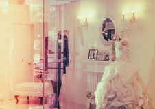 Wedding dress in window display . ( Filtered image processed vin. Wedding dress in window display ( Filtered image processed vintage effect Royalty Free Stock Photo