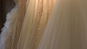Wedding dresses in a dim lit shop stock video footage