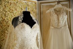 Wedding dresses on hangers and dummies Stock Images