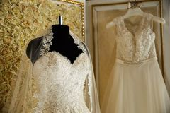 Wedding dresses on hangers and dummies Royalty Free Stock Photos