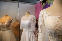 Wedding dresses on hangers and dummies Stock Photography