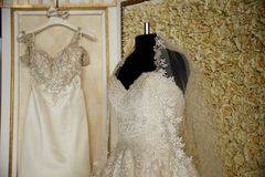 Wedding dresses on hangers and dummies Stock Photo