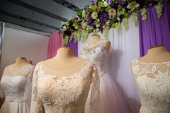 Wedding dresses on hangers and dummies Royalty Free Stock Photo