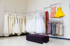 Wedding dresses on hangers in store Stock Image