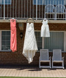 Wedding dresses. On railing royalty free stock images