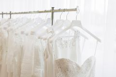 Wedding dresses in shop. Wedding dress concept stock photos