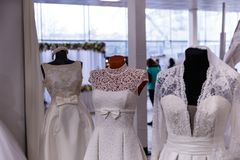 Wedding dresses wedding shop. On mannequins royalty free stock photos
