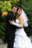 Wedding embrace. Wedding pair in the park Stock Images