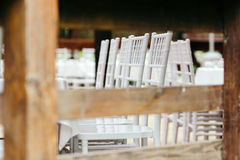 Wedding event. Chiavari chairs on the covered wooden deck. Royalty Free Stock Photo
