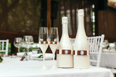 Wedding event. On table decorated with a bottle of champagne and glasses. Stock Photo