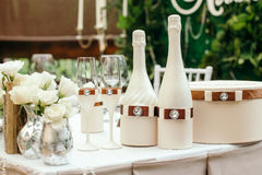 Wedding event. On table decorated with a bottle of champagne and glasses. Stock Photography