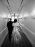 Wedding Exit. A happy newlywed couple leaves their wedding. Zoom blur effect stock images