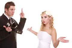Wedding expense concept. Bride groom with empty purse Royalty Free Stock Image