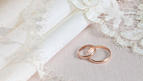 Wedding fabrics and lace. And two gold rings Royalty Free Stock Image