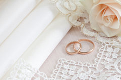 Wedding fabrics and lace. And two gold rings Royalty Free Stock Photo