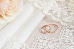 Wedding fabrics and rings. Wedding fabrics and lace and two gold rings Stock Image