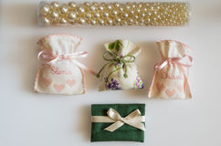 Wedding favor bags containing sugar-coated almonds , dates gift Stock Image