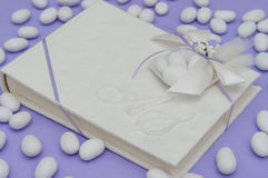 Wedding favor. A book as wedding favor, with white wedding candy royalty free stock photography