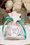 Wedding favor. Decorated with ribbon and leaf Royalty Free Stock Images