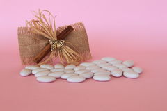 Wedding favor. On pink background and candies royalty free stock photos