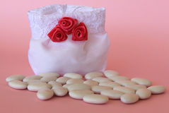 Wedding favor. Favor on pink background and confetti royalty free stock image