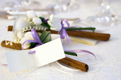 Wedding favors. Couple of wedding favors with white flowers and cinnamom stick, and a blank card for names of husband and bride Royalty Free Stock Photography